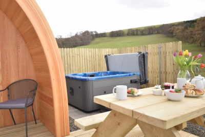 Enjoy al fresco dining and the private hot tub in the Scottish Borders